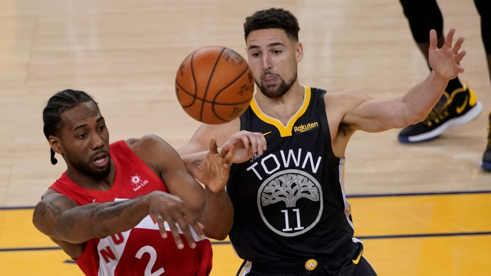 Toronto Raptors forward Kawhi Leonard (2) passes the ball in front of Golden State Warriors guard Klay Thompson (11) during the second half of Game 4 of basketball's NBA Finals in Oakland, Calif., Friday, June 7, 2019. (AP Photo/Tony Avelar)
