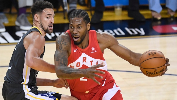 864673af046 Toronto Raptors forward Kawhi Leonard (2) drives around Golden State  Warriors guard Klay Thompson (11) during first half basketball action in  Game 4 of the ...