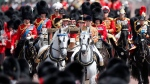 Queen Elizabeth rides in a carriage to attend the annual Trooping the Colour Ceremony in London, Saturday, June 8, 2019.  (AP Photo/Frank Augstein)