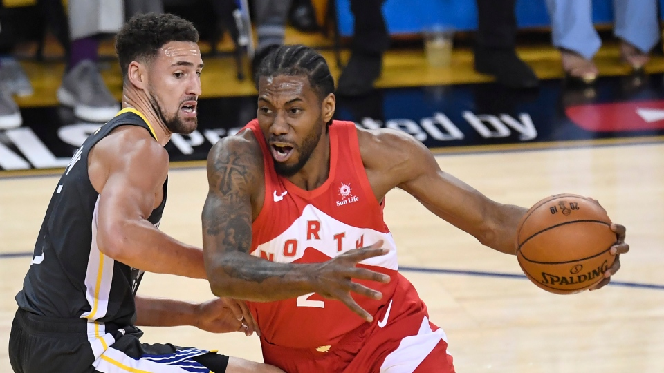 Toronto Raptors forward Kawhi Leonard (2) drives around Golden State Warriors guard Klay Thompson (11) during first half basketball action in Game 4 of the NBA Finals in Oakland, California on Friday, June 7, 2019. THE CANADIAN PRESS/Frank Gunn