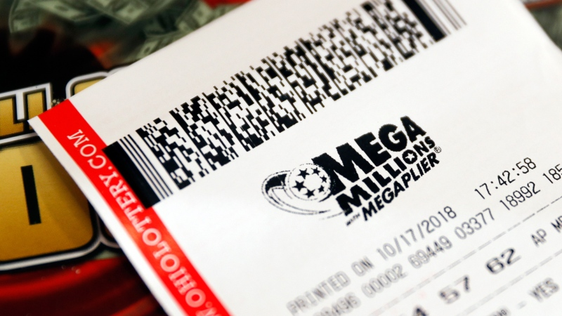 In this Oct. 17, 2018, file photo a Mega Millions lottery ticket rests on the shop counter at the Street Corner Market in Cincinnati. A lottery ticket worth $530 million in the Mega Millions draw was sold at a liquor store in San Diego, the City News Service reports. (AP Photo/John Minchillo, File)