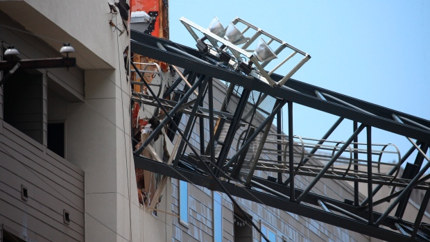 Woman killed as crane smashes into flats during Texas thunderstorms