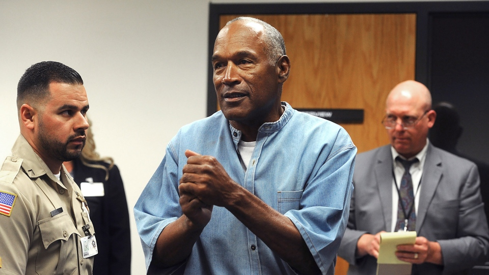 FILE - In this July 20, 2017, file photo, former NFL football star O.J. Simpson reacts after learning he was granted parole at Lovelock Correctional Center in Lovelock, Nev. (Jason Bean/The Reno Gazette-Journal via AP, Pool, File)