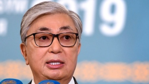Kazakhstan's then-acting President Kassym-Jomart Tokayev speaks to the media at a polling station during the presidential elections in Nur-Sultan, the capital city of Kazakhstan, Sunday, June 9, 2019. (Kazakhstan's Presidential Press Office via AP)