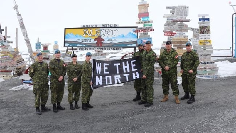 Canadian Armed Forces members hold up a banner in support of the Toronto Raptors at the Canadian Forces Station in Alert, Nunavut in a handout photo. THE CANADIAN PRESS/HO-Canadian Armed Forces