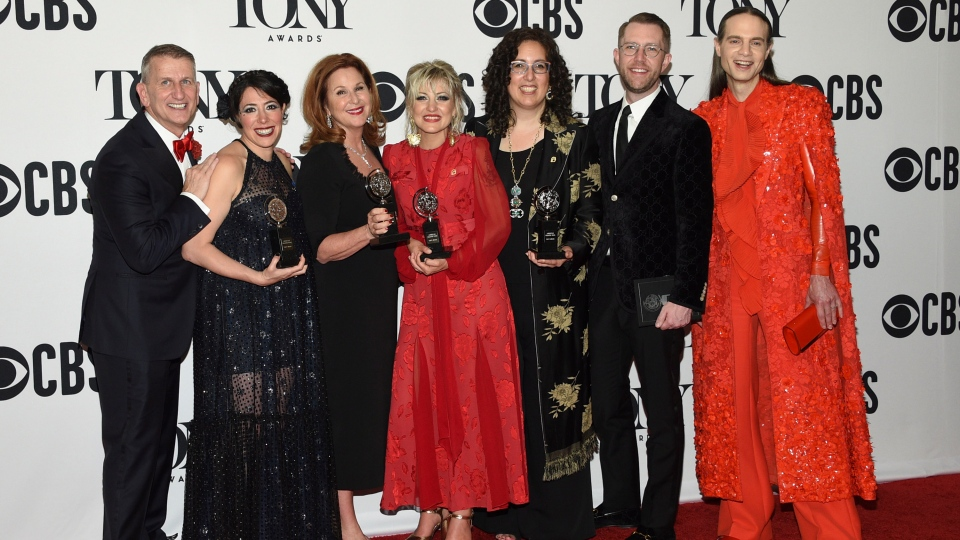 """The company of """"Hadestown"""" poses in the press room with the best musical award at the 73rd annual Tony Awards on Sunday, June 9, 2019, in New York. (Photo by Evan Agostini/Invision/AP)"""