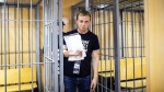 Ivan Golunov leaves the cage in a court room in Moscow, Russia, on June 8, 2019. (Evgeny Feldman/meduza.io via AP)