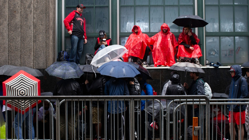 Toronto Raptors fans line up outside the Scotiabank Arena, in Toronto on Monday, June 10, 2019, to gain access to the fan area known as 'Jurassic Park' ahead of game five of the NBA Finals between the Toronto Raptors ad Golden State Warriors. (THE CANADIAN PRESS/Chris Young)