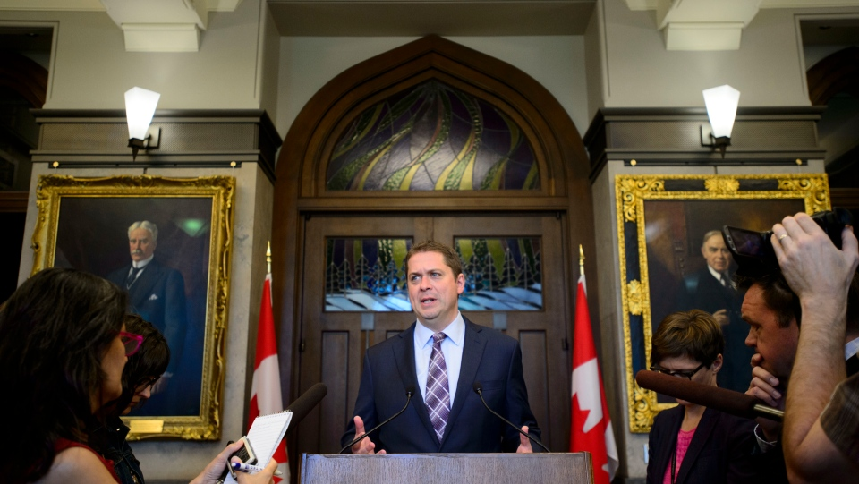 Conservative Leader Andrew Scheer talks to the media in the foyer of the House of Commons on Parliament Hill, in Ottawa on Monday, June 10, 2019. THE CANADIAN PRESS/Sean Kilpatrick