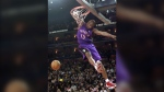 FILE - In this Feb. 12, 2000, file photo, Toronto Raptors Vince Carter hangs from his elbow on his fourth dunk during the slam dunk competition during the NBA All-Star weekend in Oakland, Calif. (AP Photo/Bob Galbraith, File)