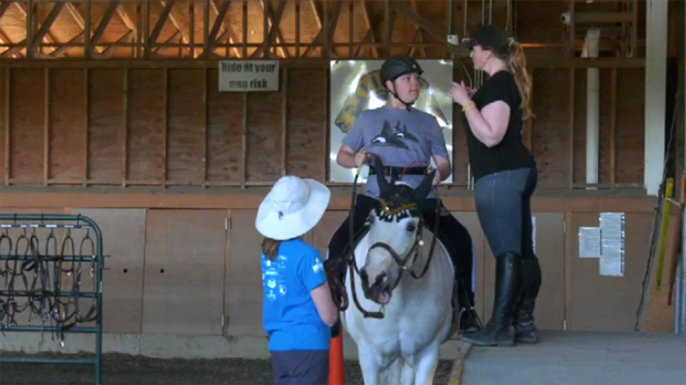 Jacob Bombardier and his horse Cherry prepare to take part in the Vancouver Therapeutic Riding Association's annual show in Central Saanich. June 8, 2019. (CTV Vancouver Island)
