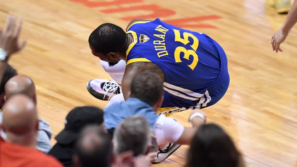 Golden State Warriors forward Kevin Durant (35) goes down with a leg injury against the Toronto Raptors during first half basketball action in Game 5 of the NBA Finals in Toronto on Monday, June 10, 2019. THE CANADIAN PRESS/Frank Gunn