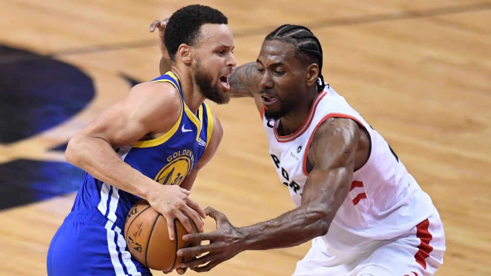 Toronto Raptors forward Kawhi Leonard (2) defends against Golden State Warriors guard Stephen Curry (30) during first half basketball action in Game 5 of the NBA Finals in Toronto on Monday, June 10, 2019. THE CANADIAN PRESS/Frank Gunn