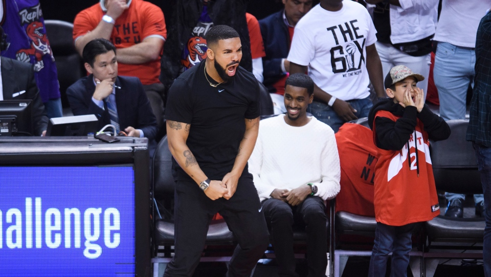 Rapper Drake reacts after a three point basket by the Toronto Raptors as they play against the Golden State Warriors during first half Game 5 NBA Finals basketball action in Toronto on Monday, June 10, 2019. THE CANADIAN PRESS/Nathan Denette