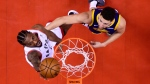 Toronto Raptors forward Kawhi Leonard (2) scores past Golden State Warriors guard Klay Thompson (11) during second half Game 5 NBA Finals basketball action in Toronto on Monday, June 10, 2019. (THE CANADIAN PRESS/Nathan Denette)