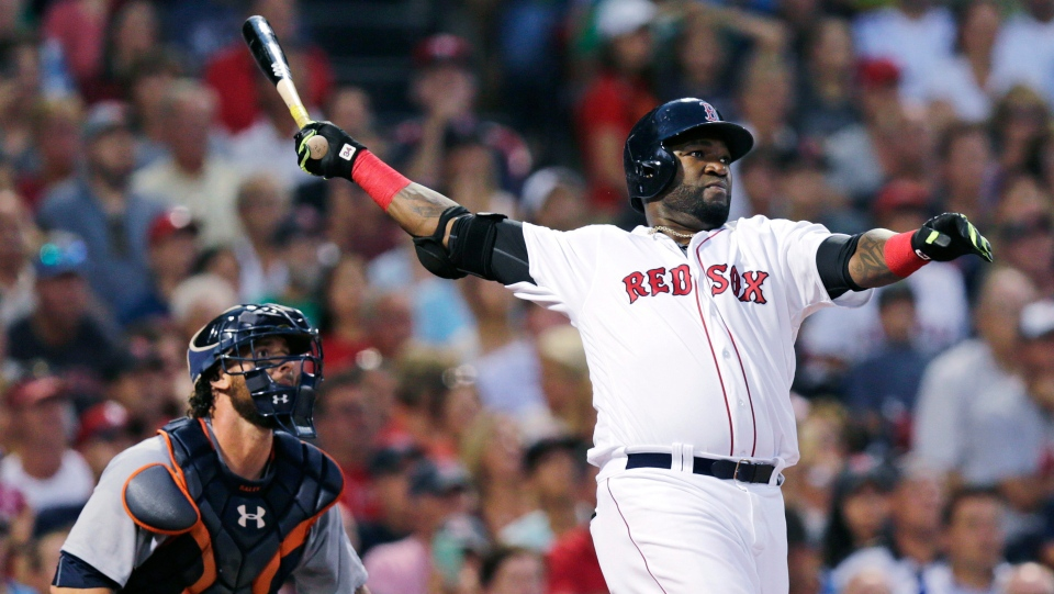 In this July 26, 2016, file photo, Boston Red Sox designated hitter David Ortiz and Detroit Tigers catcher Jarrod Saltalamacchia watch the flight of Ortiz's three-run home run during the third inning of a baseball game at Fenway Park, in Boston. AP Photo/Charles Krupa, File)