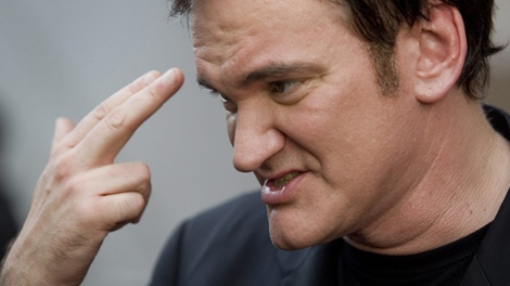 Quentin Tarantino gestures while on the red carpet for the Canadian premiere of 'Inglourious Basterds' in Toronto, Wednesday, Aug. 12, 2009. (Darren Calabres / THE CANADIAN PRESS)