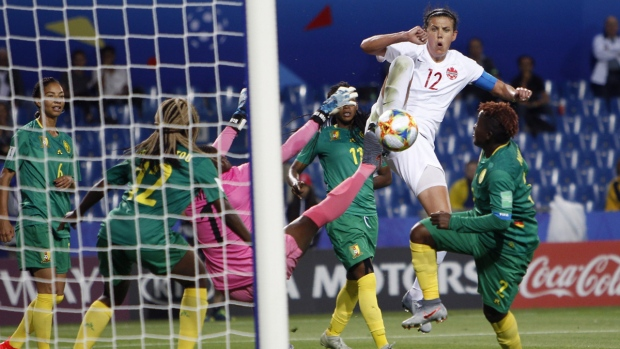 Christine Sinclair attempts a shot on goal