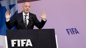 FIFA President Gianni Infantino delivers his speech during the 69th FIFA congress in Paris, Wednesday, June 5, 2019. (AP Photo/Alessandra Tarantino)