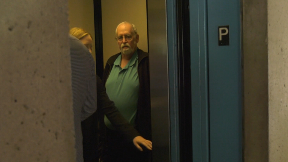 Robert Joseph Boule waits in a courthouse elevator following a hearing on June 11, 2019.