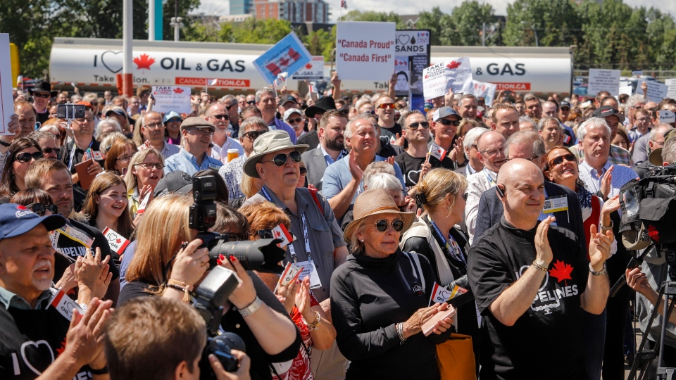 "Pro-pipeline supporters rally at what organizers call the ""largest oil and gas rally in Canadian history"" in Calgary, Tuesday, June 11, 2019. THE CANADIAN PRESS/Jeff McIntosh"