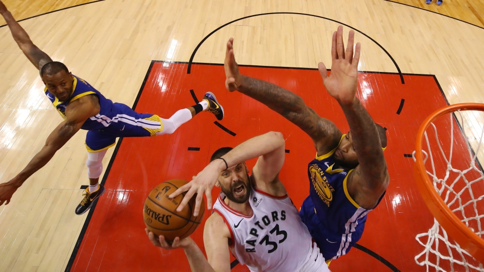 Toronto Raptors centre Marc Gasol (33) goes to the net past Golden State Warriors centre DeMarcus Cousins (0) during second half basketball action in Game 5 of the NBA Finals in Toronto on Monday, June 10, 2019. THE CANADIAN PRESS/Gregory Shamus - POOL