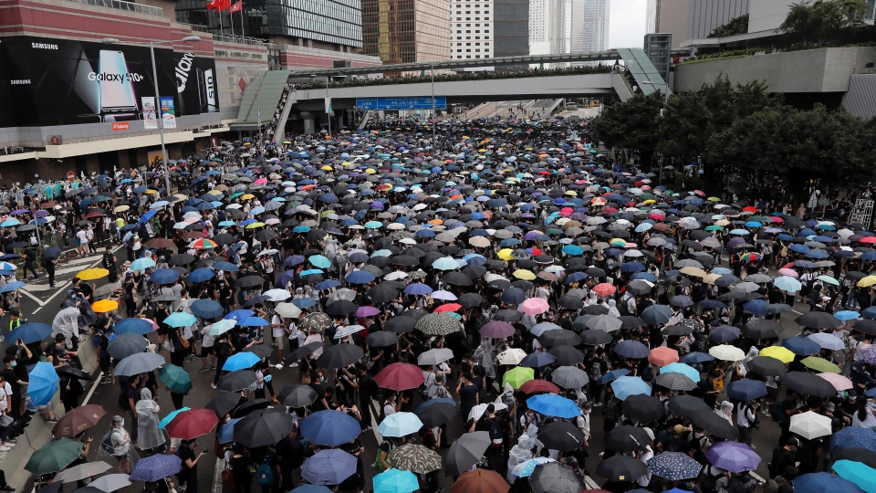 Protestors gather near the Legislative Council in Hong Kong, Wednesday, June 12, 2019. (AP Photo/Kin Cheung)