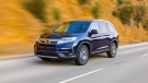 This undated photo provided by Honda shows the 2019 Honda Pilot, a well-rounded three-row family SUV that combines a pleasant ride with a flexible interior package that excels at hauling people and cargo. (American Honda Motor Co. via AP)