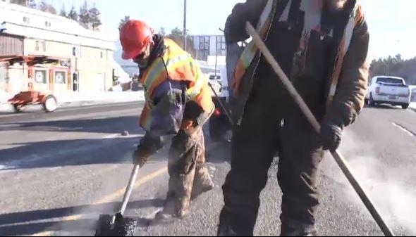 City of Greater Sudbury workers repair potholes