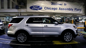 2016 Ford Explorers are seen rolling off the assembly line at the Chicago Assembly Plant in this file photo dated June 9, 2015. (AP Photo/M. Spencer Green)