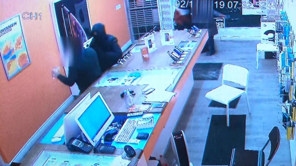 Suspects in one of 32 cellphone store robberies being investigated by police are shown in this surveillance camera image. (Toronto Police Service)