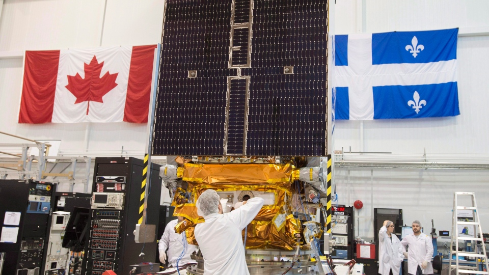 Technicians put the final touches on the second of three Radarsat Constellation Mission satellites at the MDA facility in Montreal in this file photo dated June 21, 2018. THE CANADIAN PRESS/Ryan Remiorz