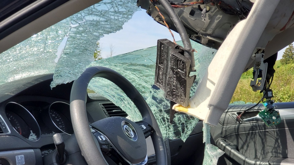 A wheel smashed into this windshield on Hwy 400, Barrie on Wed., June 12,2019 (OPP Sgt. Kerry Schmidt/Twitter)