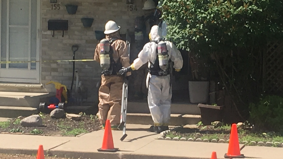 Police and firefighters wearing hazardous materials suits work at an alleged drug lab in London, Ont. on Wednesday, June 12, 2019. (Gerry Dewan / CTV London)