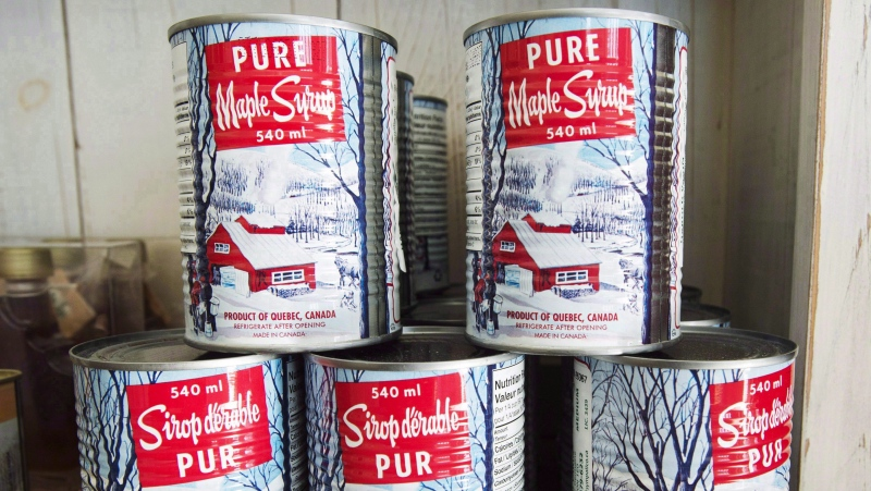 Maple syrup cans are seen at a sugar shack in Oka, Que., on February 10, 2017. (THE CANADIAN PRESS/Ryan Remiorz)