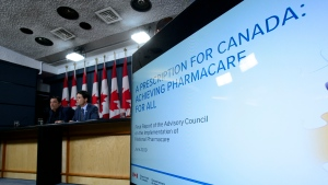 Dr. Eric Hoskins, Chair of the Advisory Council on the Implementation of National Pharmacare, is accompanied by Vincent Dumez, Member of the Advisory Council on the Implementation of National Pharmacare, during a press conference at the National Press Theatre in Ottawa on Wednesday, June 12, 2019. (THE CANADIAN PRESS / Sean Kilpatrick)