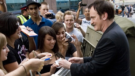 Quentin Tarantino signs autographs for fans at the Canadian premiere of 'Inglourious Basterds' in Toronto on Wednesday, Aug. 12, 2009. (Darren Calabrese / THE CANADIAN PRESS)