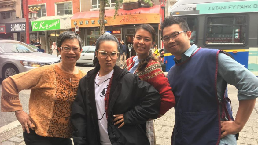 New Town Bakery and Restaurant co-owner Susanna Ng (left) takes a picture with actor and comedian Ali Wong (centre) alongside two staff members. (CTV News)