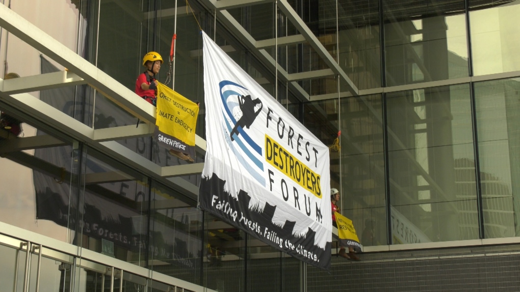 Activists climb onto Vancouver Convention Centre in climate protest