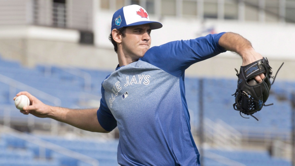 Toronto Blue pitcher Jordan Romano of Markham, Ontario throws long toss prior to the official start of Spring Training in Dunedin, Florida on Monday February 12, 2018. Romano made his major league debut with the Toronto Blue Jays on Wednesday night, pitching a perfect inning against the Baltimore Orioles. THE CANADIAN PRESS/Frank Gunn