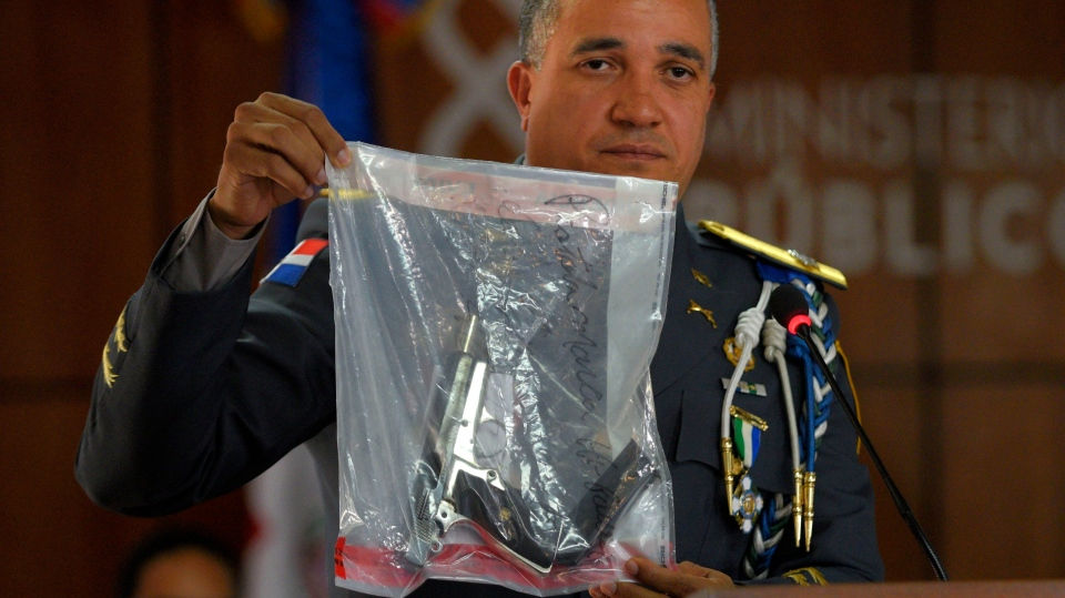 The director of the National Police, General Ney Aldrin Bautista Almonte shows the weapon that was used to shoot former Boston Red Sox slugger David Ortiz, during a press conference at the Attorney General's Office in Santo Domingo, Dominican Republic, Wednesday, June 12, 2019. (AP Photo / Roberto Guzman)