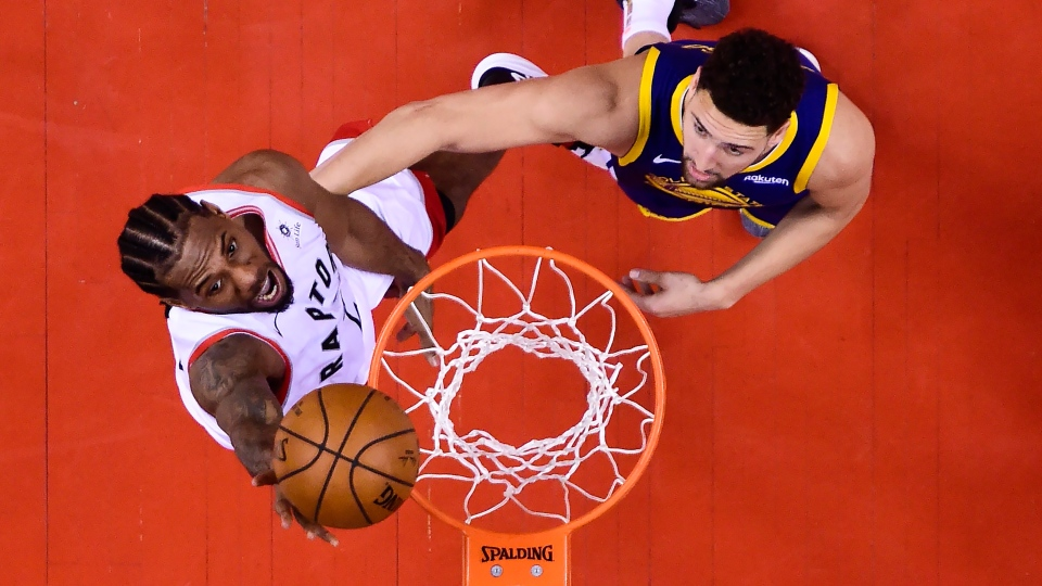 Toronto Raptors forward Kawhi Leonard (2) scores past Golden State Warriors guard Klay Thompson (11) during second half Game 5 NBA Finals basketball action in Toronto on Monday, June 10, 2019. THE CANADIAN PRESS/Nathan Denette