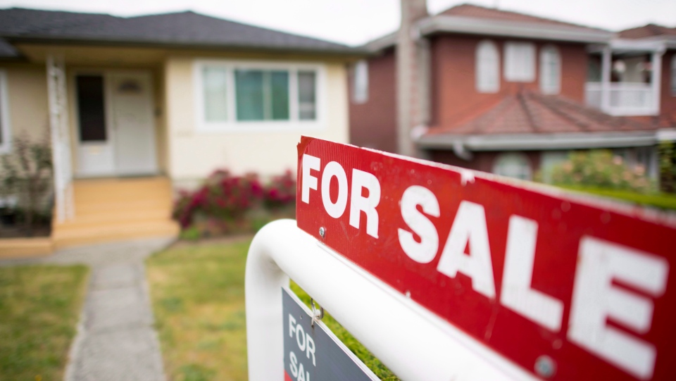 A real estate sign is pictured in Vancouver on June, 12, 2018. (THE CANADIAN PRESS/Jonathan Hayward)