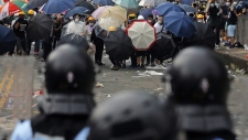 Protesters and police in Hong Kong