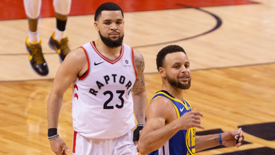 Golden State Warriors Stephen Curry (right) celebrates in front of Toronto Raptors Fred VanVleet at the final buzzer as Warriors beat the Raptors 106-105 in game five of the NBA Finals in Toronto on Monday, June 10, 2019. THE CANADIAN PRESS/Chris Young