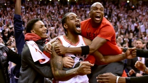 Toronto Raptors forward Kawhi Leonard (2) celebrates his last-second basket with teammates at the end of second half NBA Eastern Conference semifinal action against the Philadelphia 76ers, in Toronto on Sunday, May 12, 2019. (THE CANADIAN PRESS / Frank Gunn)