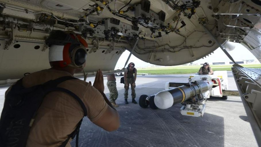 Aviation ordnancemen load MK-54 torpedos aboard a P-8A Poseidon aircraft in Okinawa, Japan. (U.S. Navy)