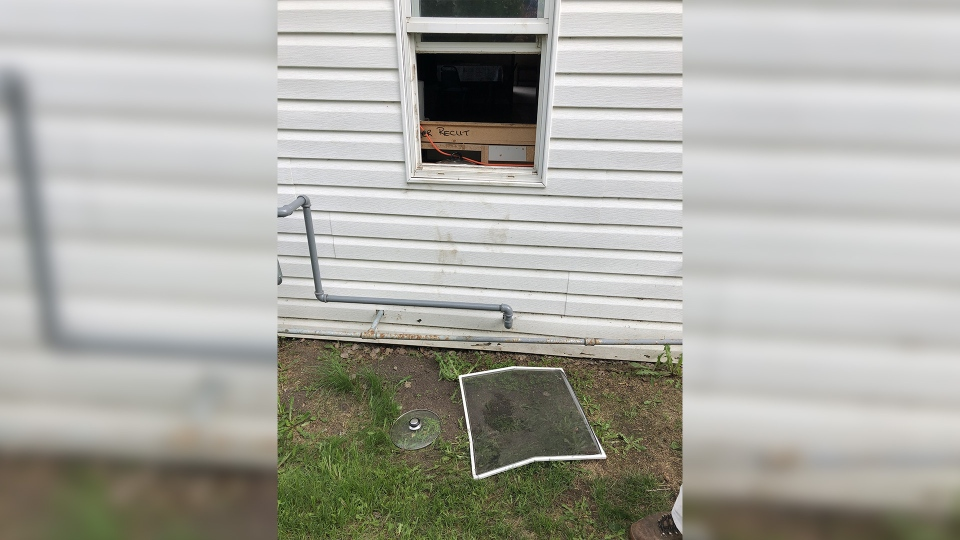 Barrie Termeer says a black bear climbed through this window and helped himself to a bowl of rice on the kitchen table.