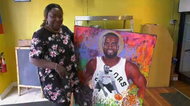 Yvette Kavungu  is seen next to a colourful portrait of Raptors star Serge Ibaka.