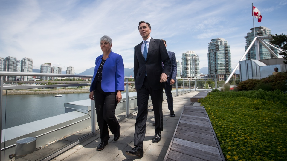 B.C. Finance Minister Carole James, left, and Federal Minister of Finance Bill Morneau arrive for a news conference after attending a meeting about money laundering and terrorist financing, in Vancouver, on Thursday June 13, 2019. THE CANADIAN PRESS/Darryl Dyck